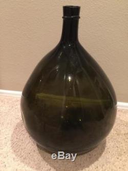 Vintage charcoal / dark olive green glass hand blown demijohn carboy wine bottle
